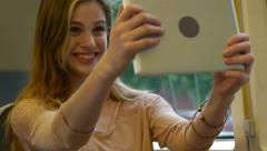 Teen Girl Takes A Selfie, For Fun, On A Train Ride Through The City - stock footage