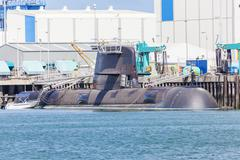 Submarine in a naval shipyard - stock photo