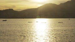Rowing in the sea at sunset - stock footage