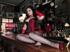 Stock Photo of Cabaret woman lying on a bar