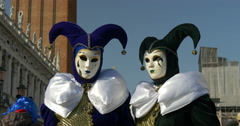 Two venetian masks black and white in San Marco square Stock Footage