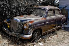 Rusted old car - stock photo