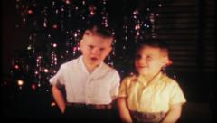 1911 - boys sing Christmas songs for family at home - vintage film home movie - stock footage