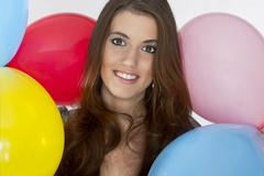 Stock Photo of Young Brunette Model with Balloons
