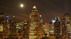 moon raising over new york city skyline. metropolis night lights - stock footage