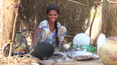 Girl prepares chapati in Thar desert where the annual Pushkar Camel Mela. India Stock Footage