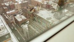 looking through window seeing snowfall outside. winter snow background - stock footage