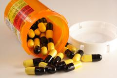 Prescription Drugs Spilling from Bottle - stock photo