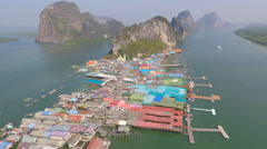 Village in the sea aerial Thailand Stock Footage