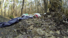 Human influence on  nature. Garbage in wood Stock Footage