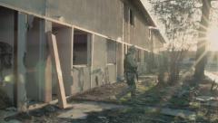 Soldier Patrolling Outside Rundown Building (Multiple Shots) Stock Footage