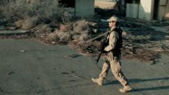 Soldier Patrolling Rundown Neighborhood 2 Stock Footage