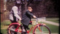 1920 - dad helps son ride a bike for first time - vintage film home movie Stock Footage