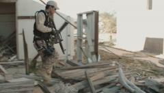 Soldier Patrolling Through Rubble Stock Footage
