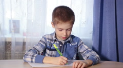 Child doing homework headache, tired boy to do the work video Stock Footage