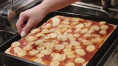 Woman applaying hotdogs on the homemade pizza. Shot in slowmotion Stock Footage