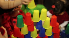 pyramid of colored glasses on birthday party - stock footage