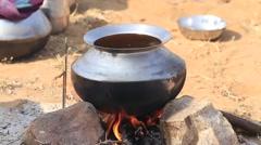 Metal pot with food on fire, Pushkar, India - stock footage