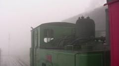 Snowdon mountain railway steam engine waiting at summit Stock Footage
