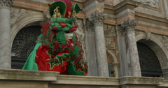 Venetian mask red and green on a loggia Stock Footage