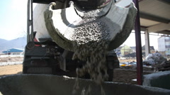 Concrete falling from mixer Stock Footage