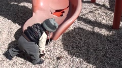 Baby climbs on the broken slide Stock Footage