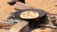 Indian chapatti on fire, Pushkar, India Stock Footage