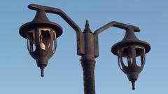 Broken lanterns against the blue sky Stock Footage