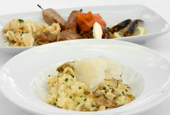 Mushroom Risotto and an Entree Tasting Plate Stock Photos