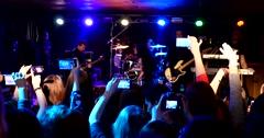 Cheering spectators make photo of singer on rock concert via smartphone Stock Footage