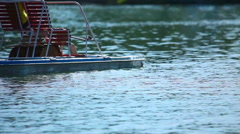 Pedalo on the Aya lake Stock Footage