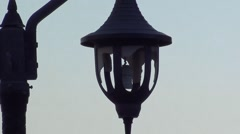 Lapm post with broken lamps zoom out Stock Footage
