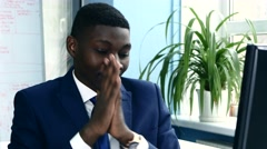 African American in a suit rubbing his hands before starting work Stock Footage