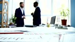 Businessmen contracted and shook hands. Focus on documentation. The camera moves Stock Footage