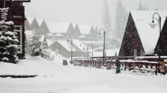 A man with a shovel removes snow on the street Stock Footage