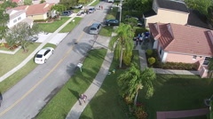 Street with garage sales aerial Stock Footage