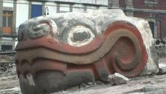 Stone Znake Head of Aztec God Quetzalcoatl in Tenochtitlan Ruins, Mexico City Stock Footage