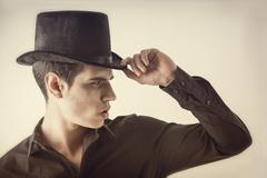 Portrait of a Young Vampire Man with Black Shirt and Top Hat Stock Photos