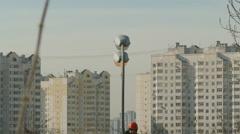 Stock Video Footage of Repairman mast climber and street lighting (wake up)