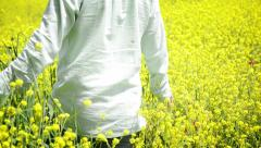 Man Walking in the Field - stock footage