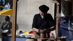 Stock Video Footage of Pottery craftsman, craft market, tradition fair