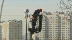 Repairman mast climber and street lighting Stock Footage