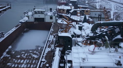Winter on river with old ships covered with snow aerial shot Stock Footage