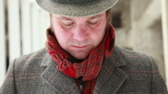 Frontal close up of man with the hat, coat and red scarf Stock Footage