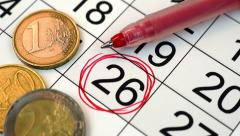 26 date circled on the calendar, euro coins and pen Stock Footage