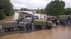 Army and police rescue teams saving people from heavy floods. Stock Footage