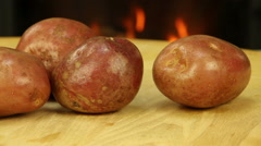 Pink unpeeled potatoes Stock Footage