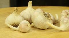 Garlic on a wooden boards background Stock Footage