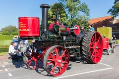 NIEUWEHORNE, THE NETHERLANDS - SEP 28: Old steam tractor in a countryside par - stock photo
