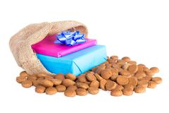 Jute bag with ginger nuts and presents, a Dutch tradition at Sinterklaas even - stock photo